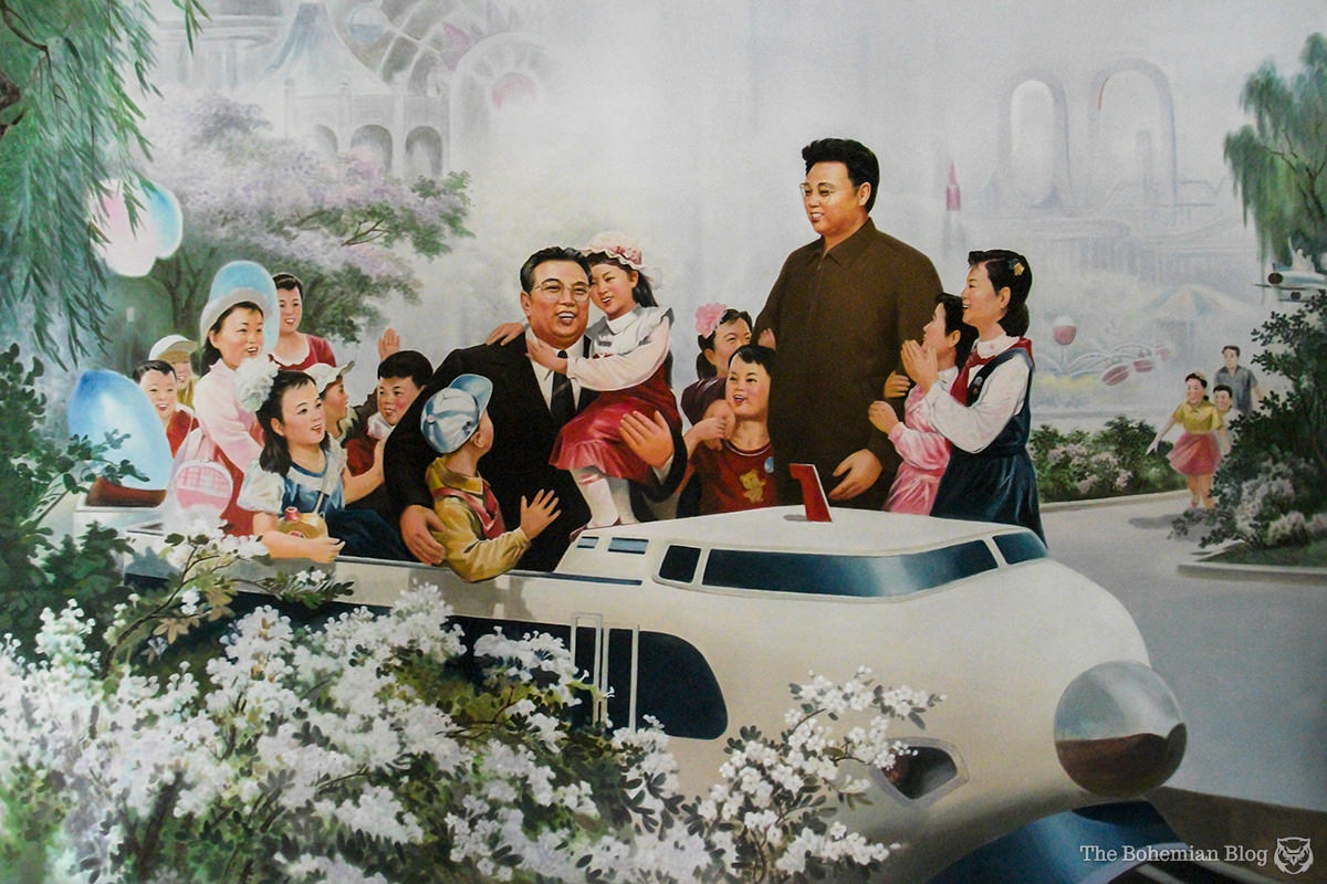 Painting of Kim Il-sung and Kim Jong-il in a Pyongyang school.