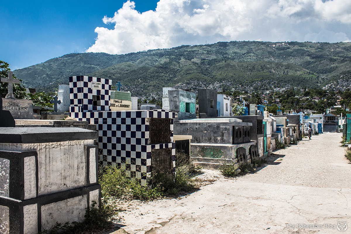 The cemetery sits on the edge of Port-au-Prince, beneath the mountains.