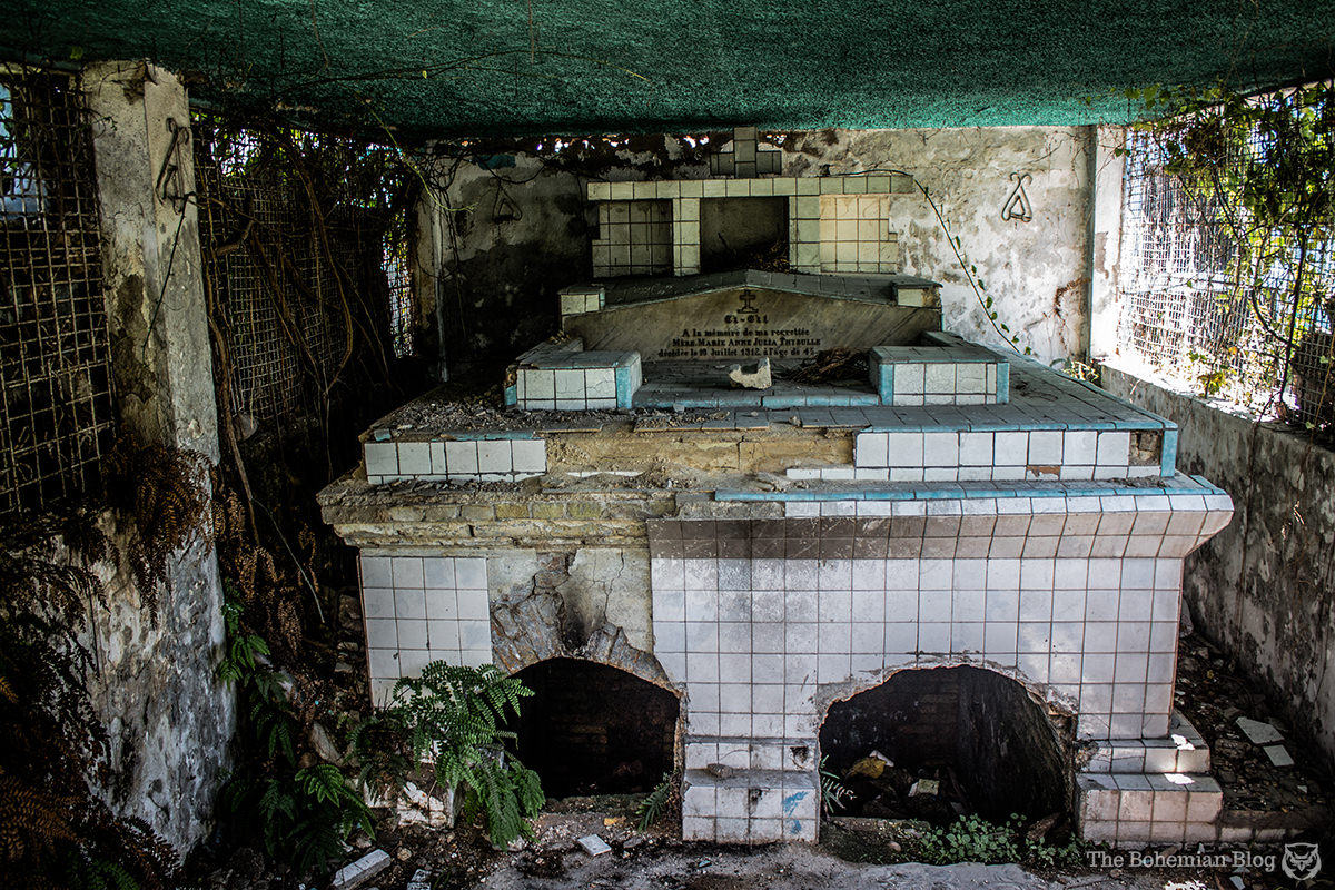 This damaged crypt sits over a deep grave, now filled with murky water.