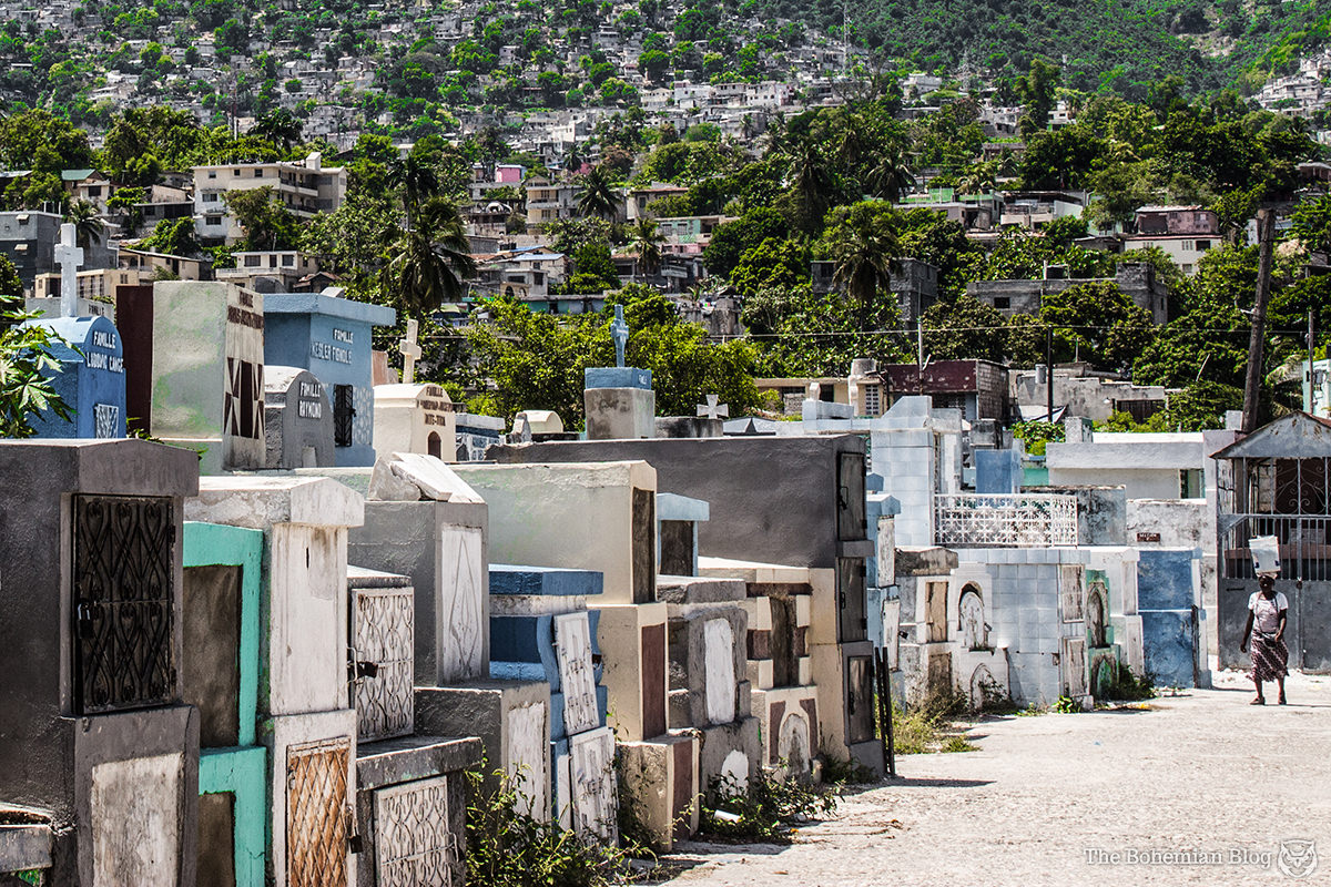A woman walks between the rows of graves at Le Grand Cimetière. Port-au-Prince, Haiti.