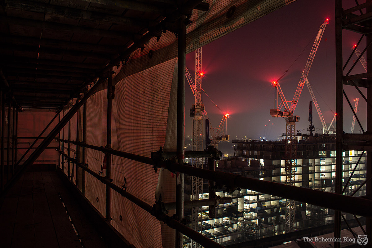 Urban Exploration: Climbing a scaffold-clad chimney at Battersea Power Station, London.