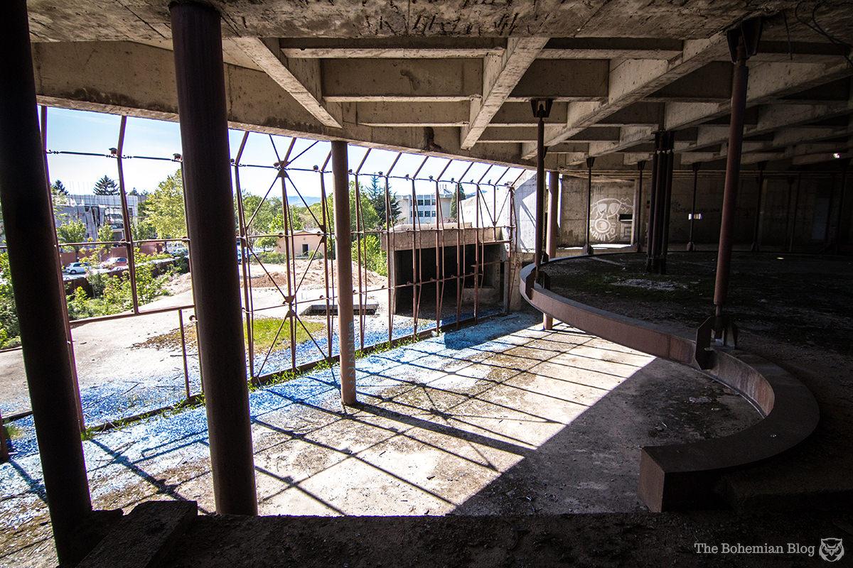 Broken glass and gantries on the ground floor plaza. Nikšić, Montenegro.