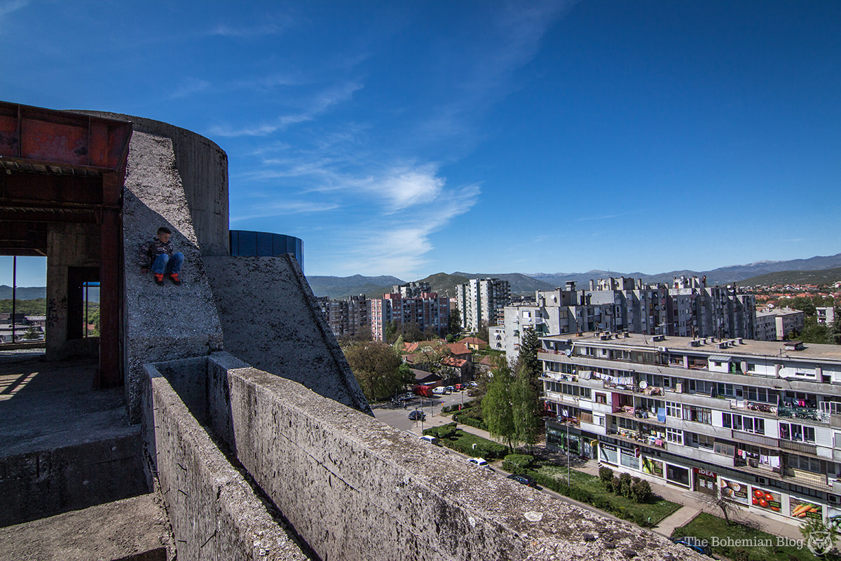 A young citizen of Nikšić climbs to the building's peak.