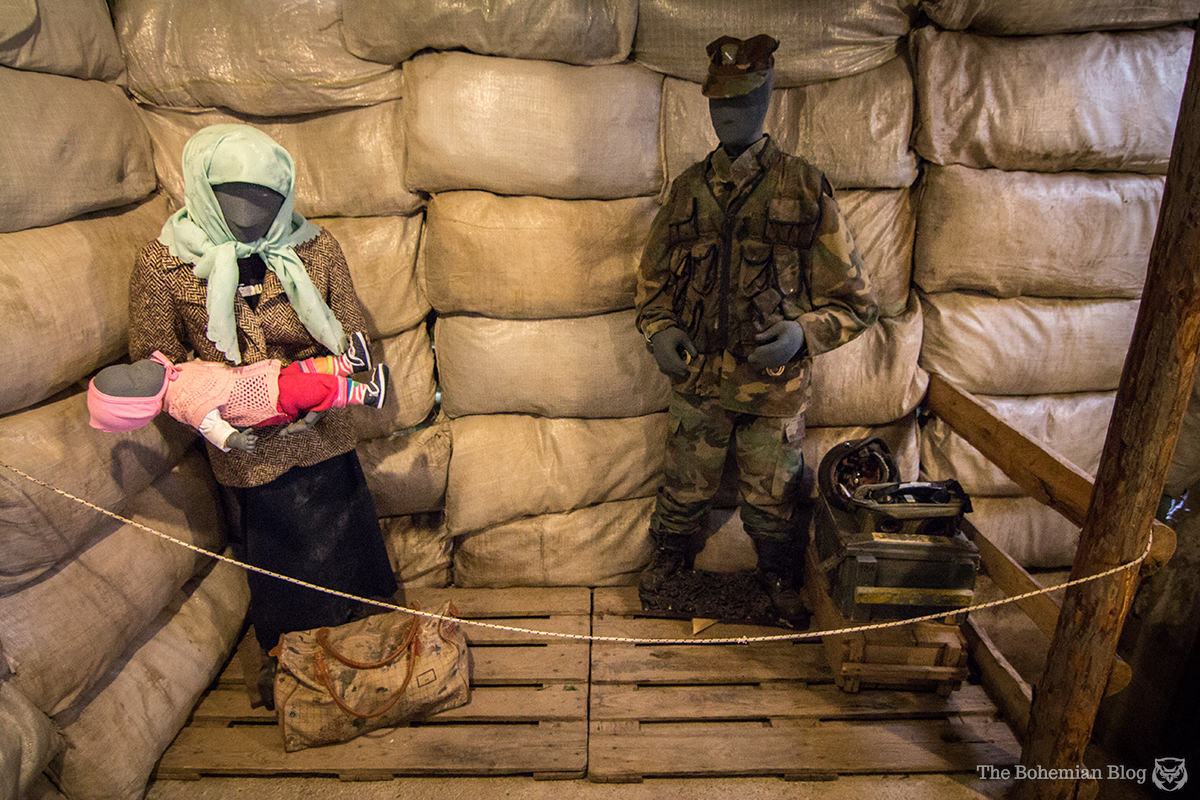 Exhibits inside the Sarajevo Siege Tunnel Museum show refugees and soldiers.