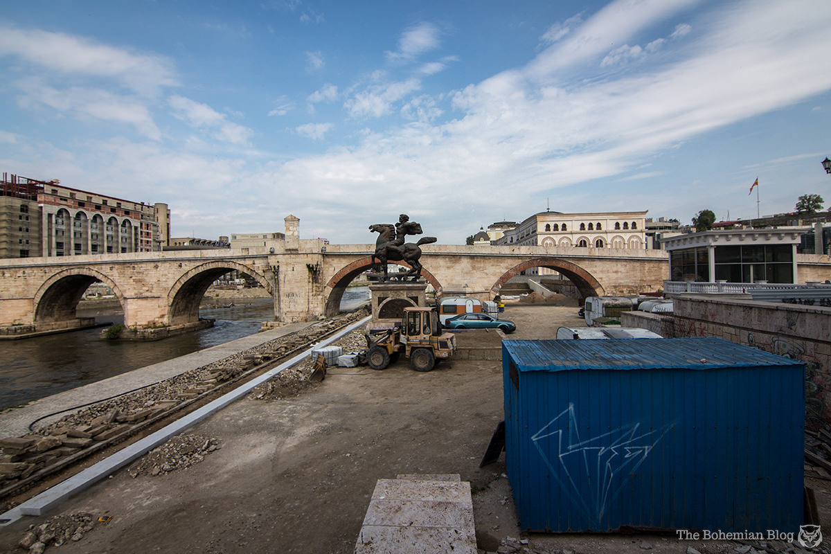 The 'Monument to Karposh' watches over a construction site in central Skopje. Below: The project continues.
