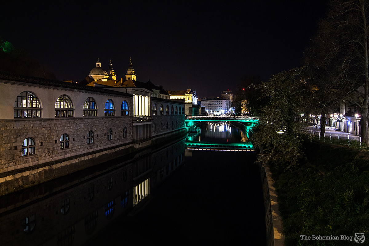 View from the Dragon Bridge in Ljubljana, with the Cathedral of St Nicholas just visible in the distance.