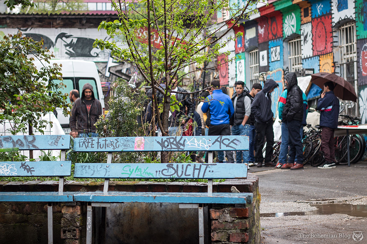 At Metelkova Mesto, a group of Syrian refugees (and Moroccan migrants) wait for a delivery of free bicycles.