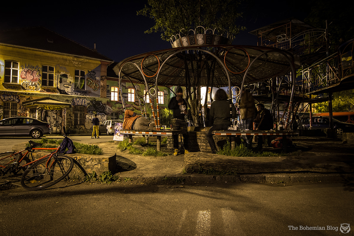 Migrants, refugees and backpackers mingle in the courtyard at Metelkova.