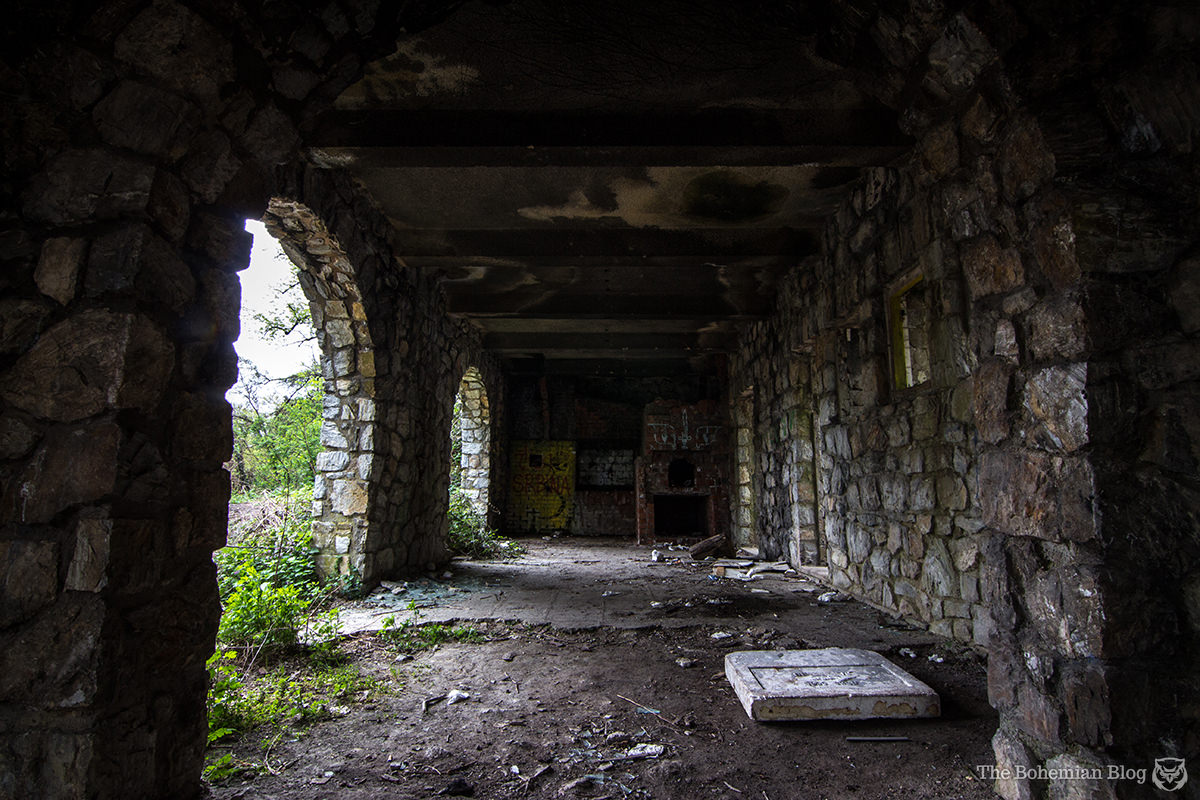 Creepers and graffiti decorate what remains of the former villa.