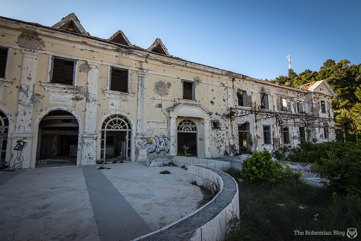 The Grand Hotel's facade carries the scars of gunfire and mortar bombing. Kupari, Croatia.