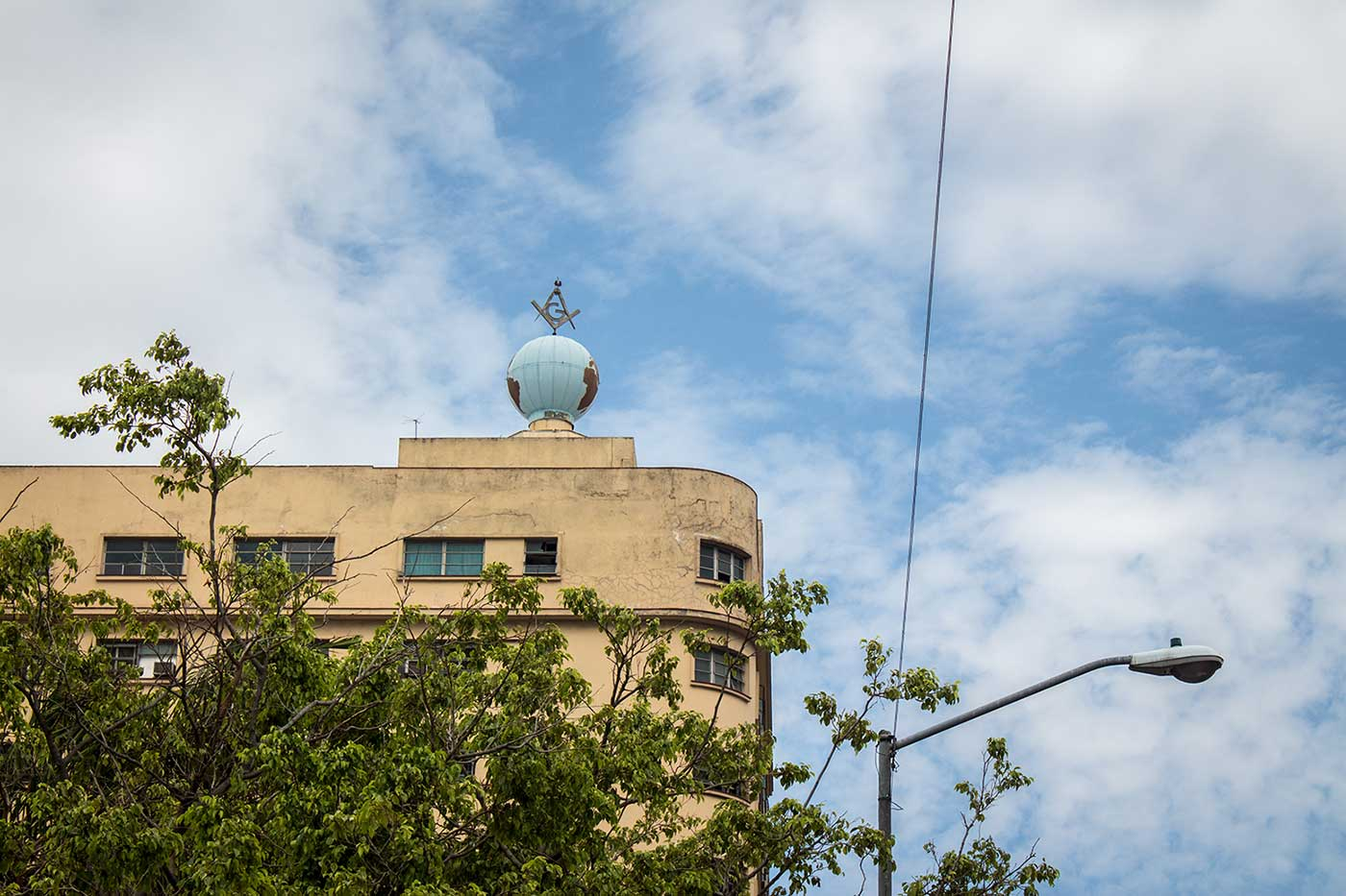 A square & compass adorn the globe on top of Cuba's Masonic headquarters.