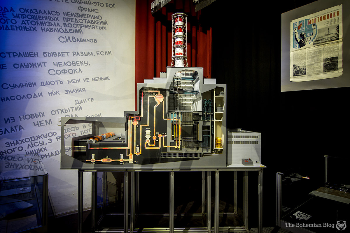 A light-up display of a power plant in cross-section teaches how nuclear power is harnessed.