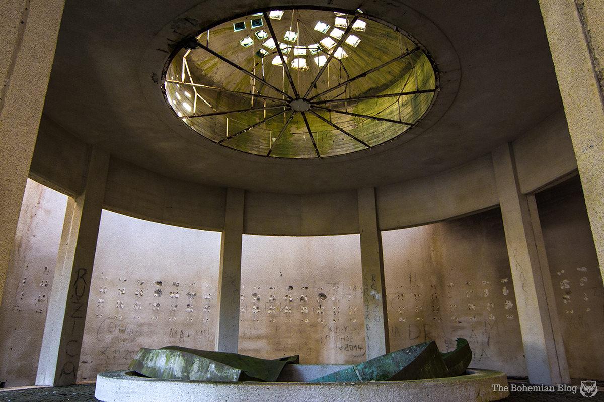 Broken glass skylights inside the lower memorial space. Korčanica Memorial Zone, Bosnia.