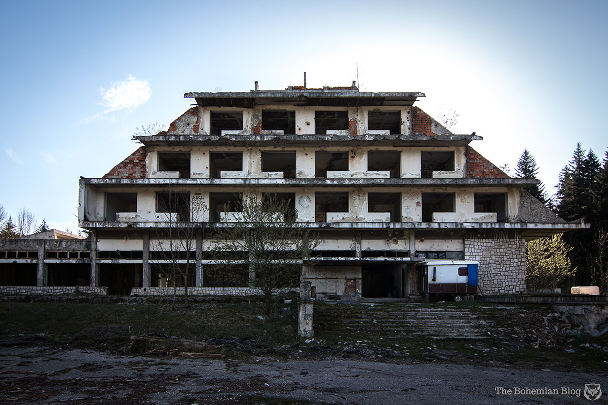 An abandoned hotel marks the entrance to the Korčanica Memorial Zone, Bosnia.