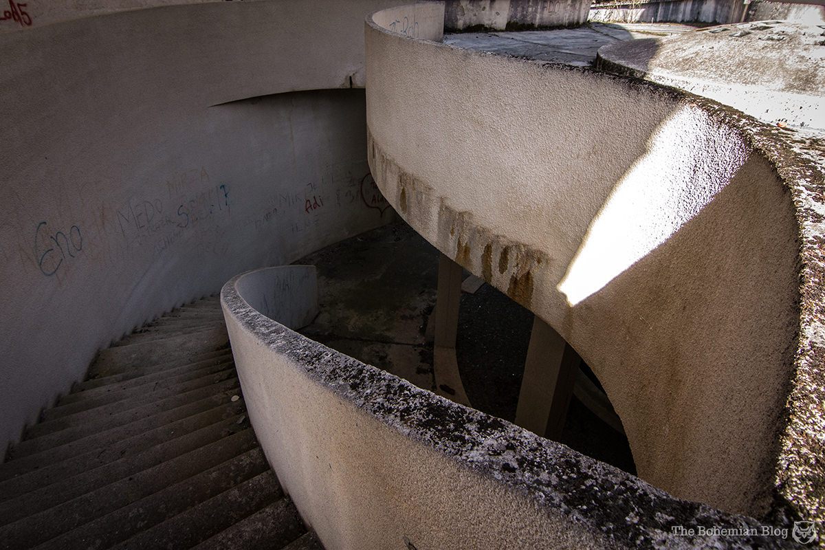 A curving stairway connects two interior levels of the former memorial house on Mount Grmeč.