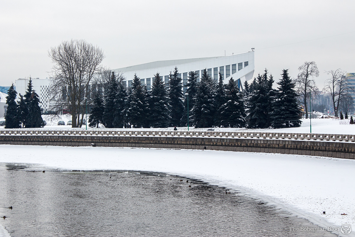 Minsk's Palace of Sports rises from the pines beyond the Svislach River.