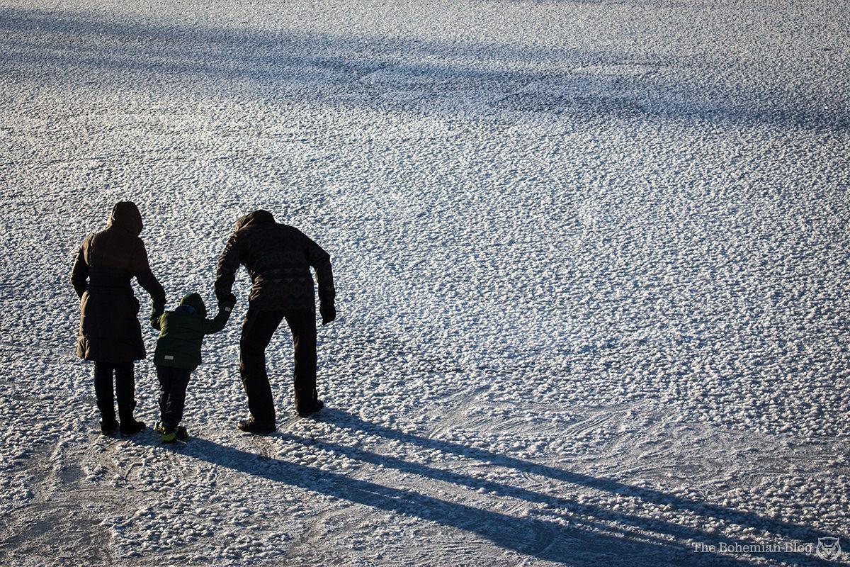 A family skates on the frozen Svislach River.
