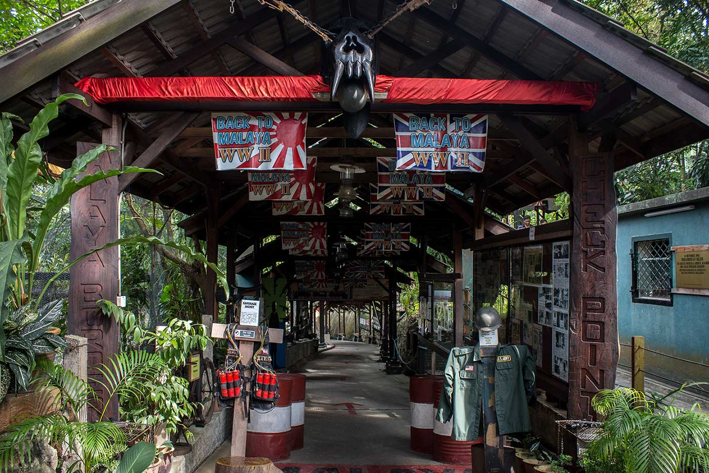 A massive wooden skull, rusted rifles and a Kamikaze bomb vest decorate the entrance to the Penang War Museum.