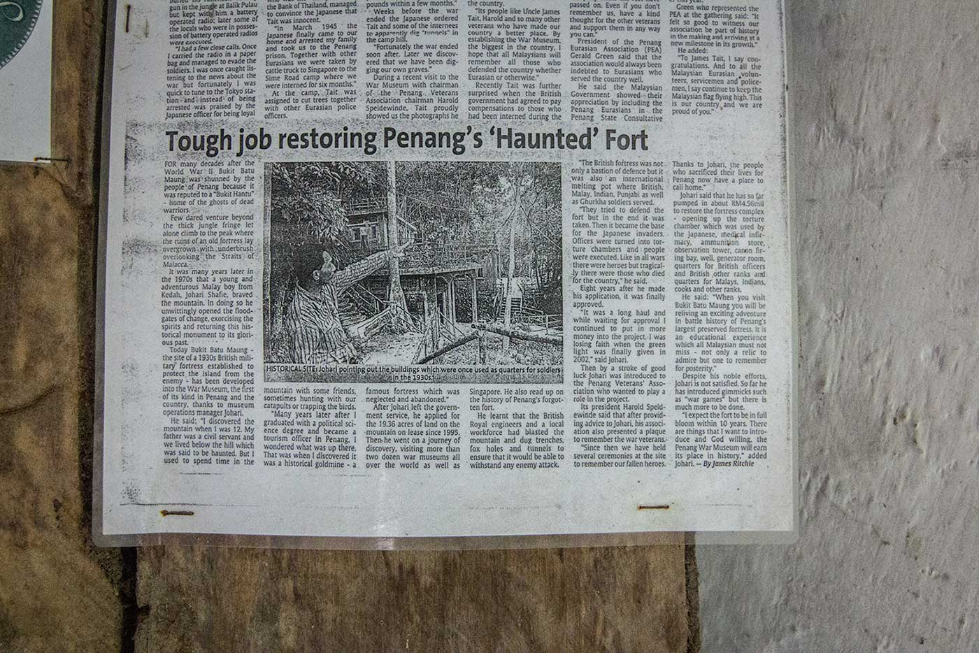 """Tough job restoring Penang's 'Haunted' Fort."" A local newspaper clipping from 2002."
