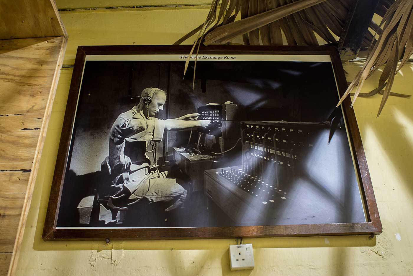 Inside the tunnel, a framed photo of a British Army radio operator.