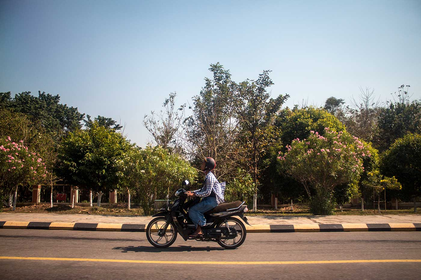 A commuter travels down a Naypyidaw highway.