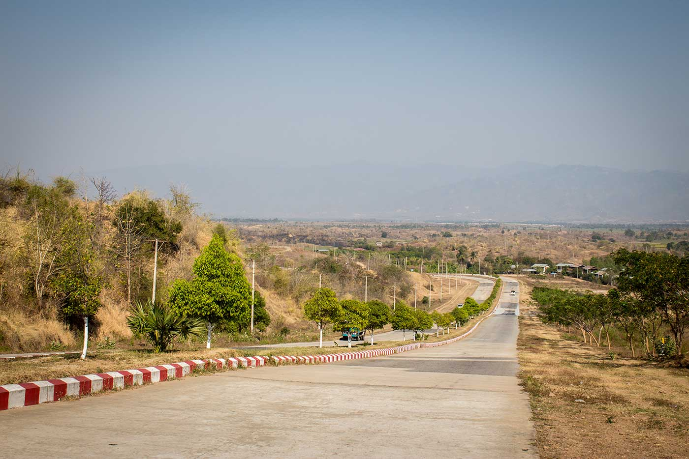 The road out of Naypyidaw, and beyond, the mountains of central Myanmar.