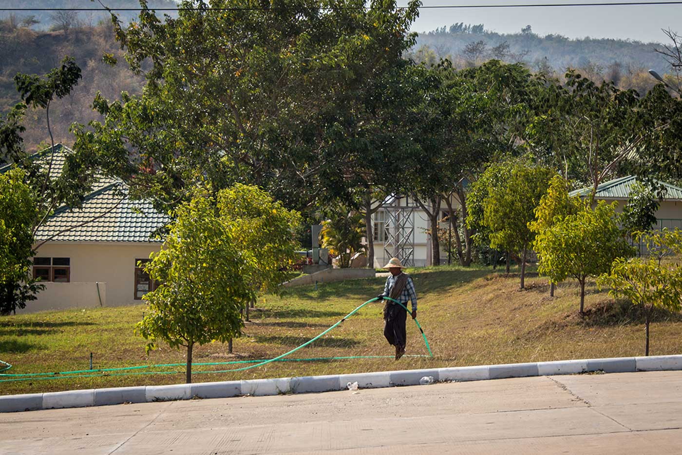 A Naypyidaw resident waters his lawn.
