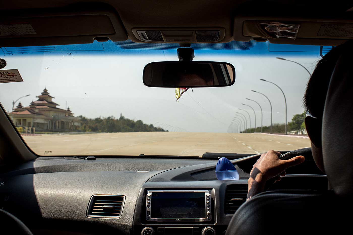 Driving into the Ministry Zone on that massive, 20-lane highway. Naypyidaw, Myanmar.