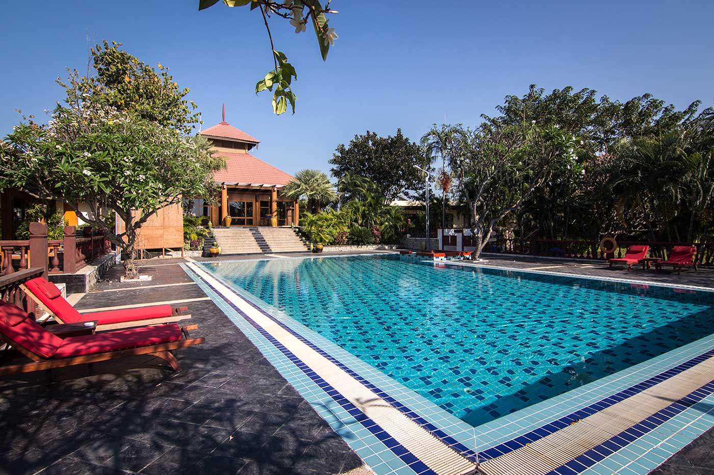 Swimming pool and sun loungers at Naypyidaw's Aureum Palace Hotel.