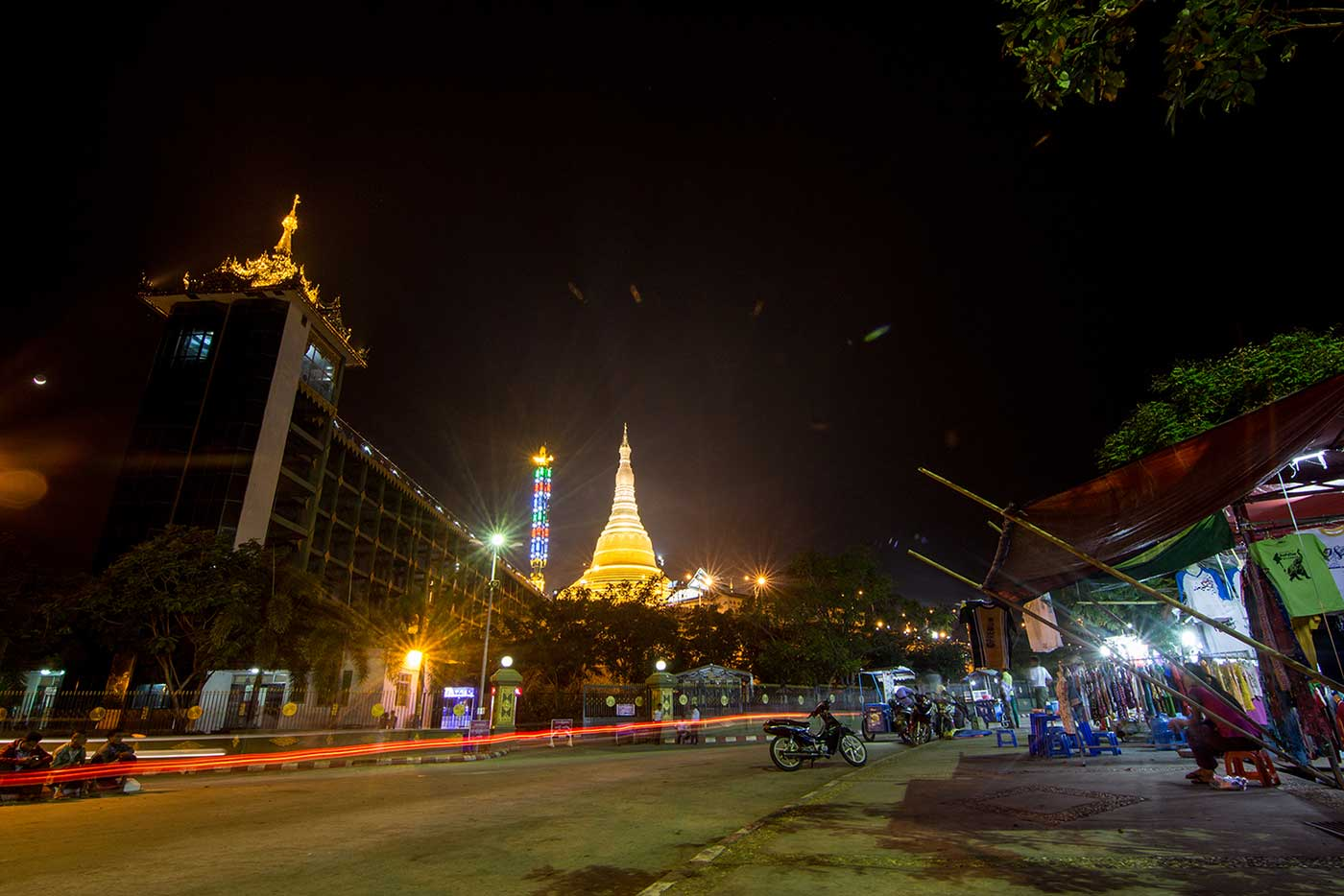 Naypyidaw by Night: markets and motorbikes in a street near the Uppatasanti Pagoda.