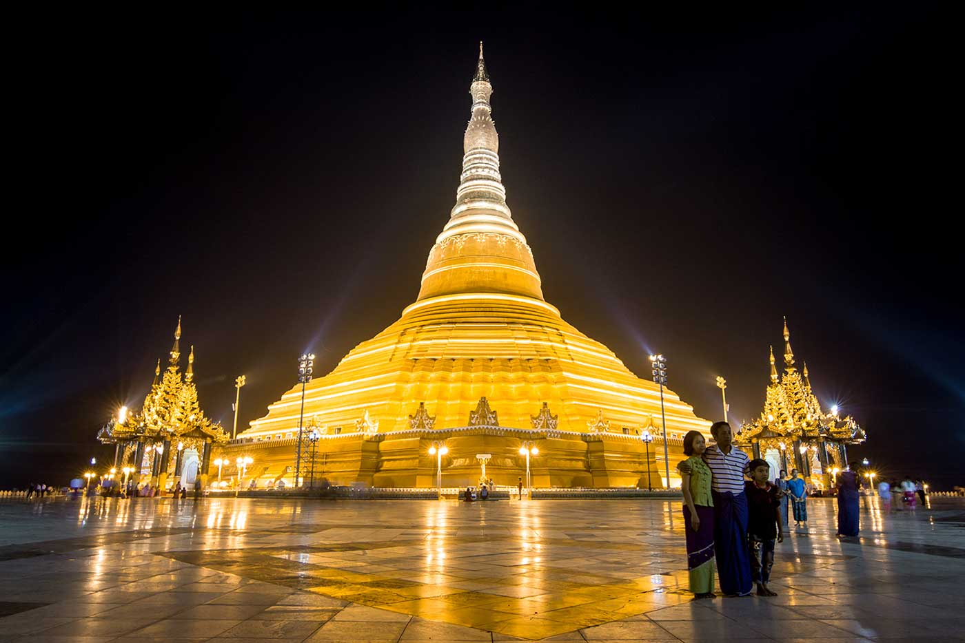 Locals pose for photos outside the Uppatasanti Pagoda.