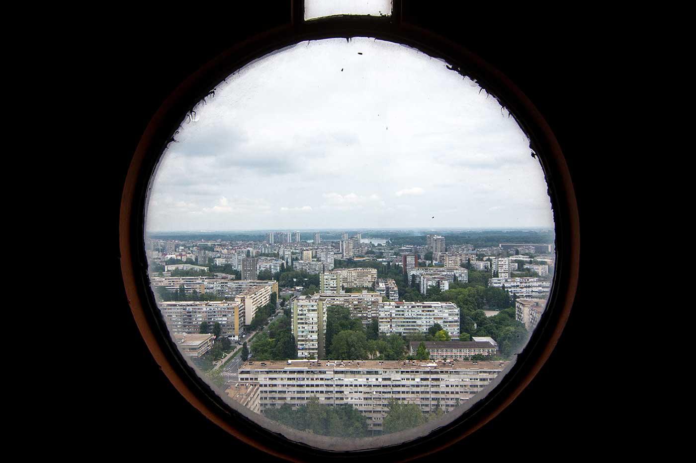 Novi Beograd, Serbia, as seen through the 30th floor porthole of the Western City Gate.