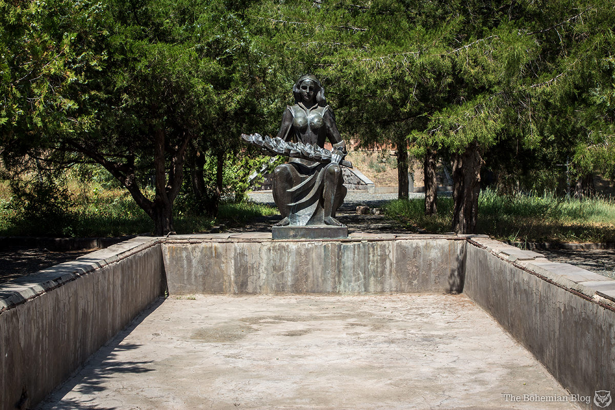 A likeness of Mother Armenia overlooks empty water fountains in a memorial complex at Ujan, Armenia.