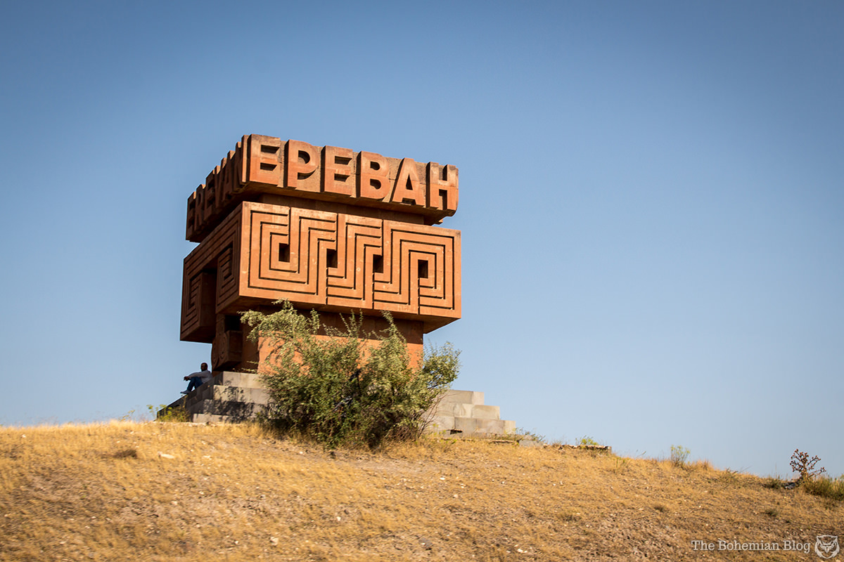 A Soviet-era monument formed from local stone welcomes visitors to the Armenian capital: Ереван or Yerevan.