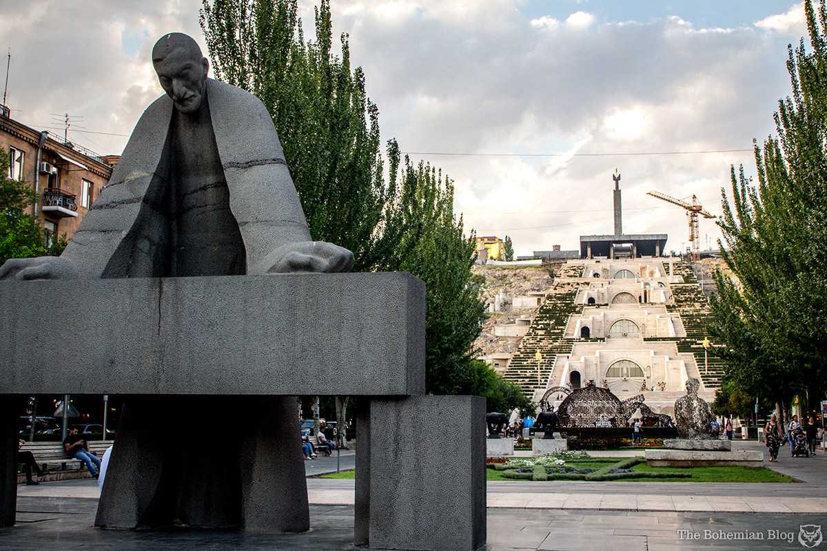 A statue of Alexander Tamanyan stands before the Yerevan Cascade.
