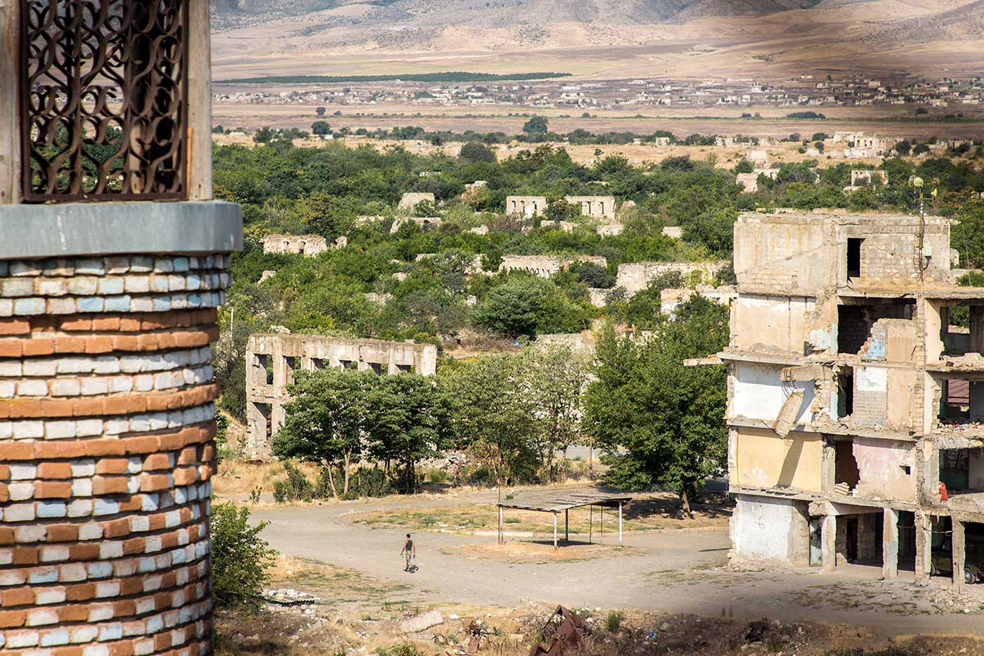 A lone figure strolls the empty streets of Agdam. Nagorno-Karabakh.