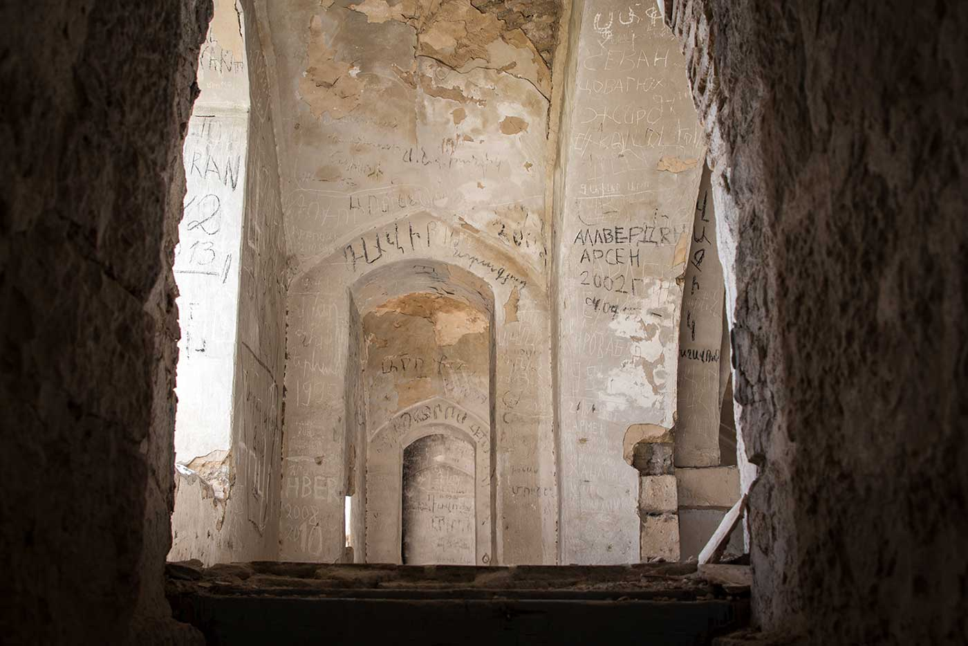 The interior of Agdam's mosque has been burned, looted and graffitied. Agdam, Nagorno-Karabakh.