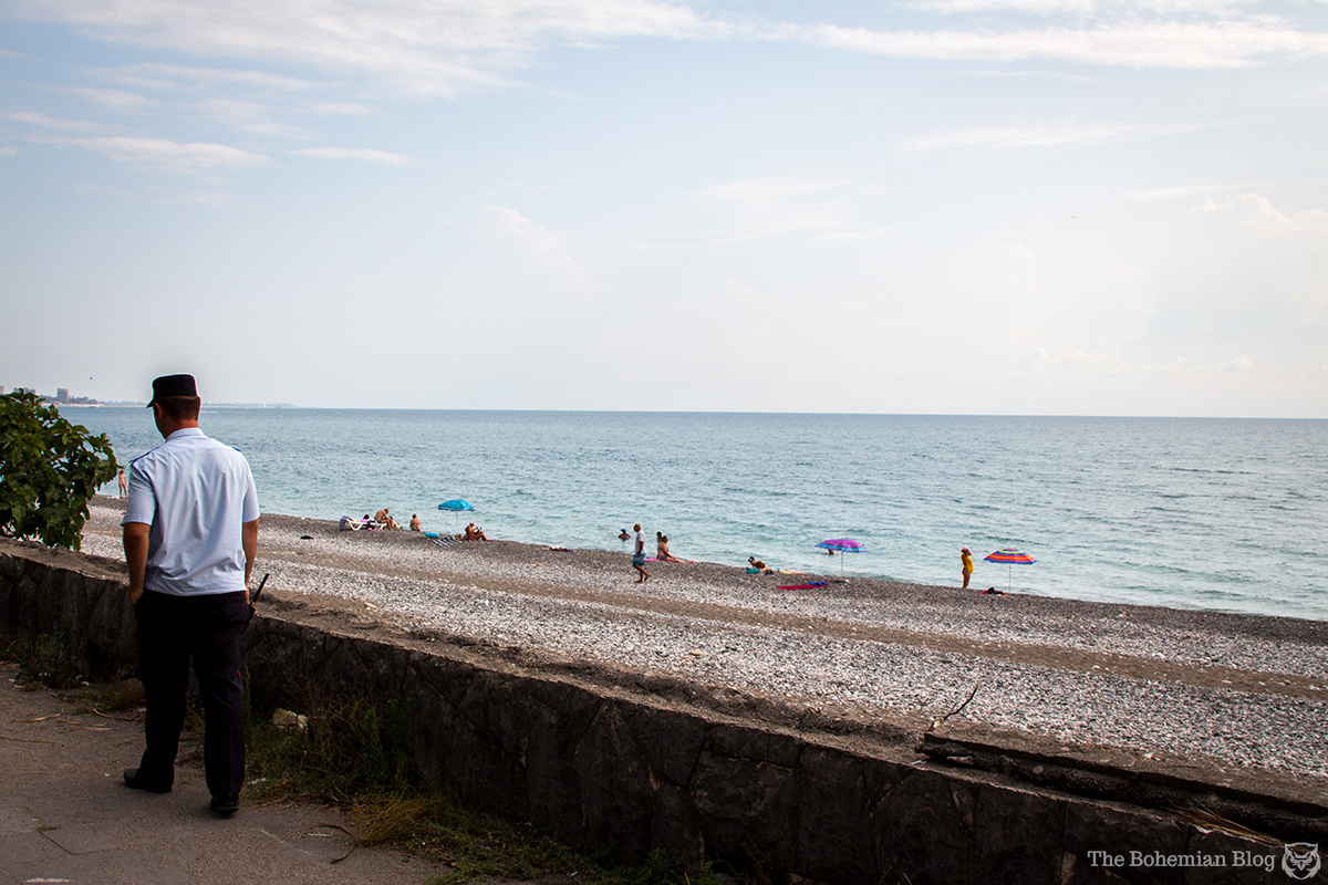 A police officer patrols the beach at Gagra, Abkhazia.