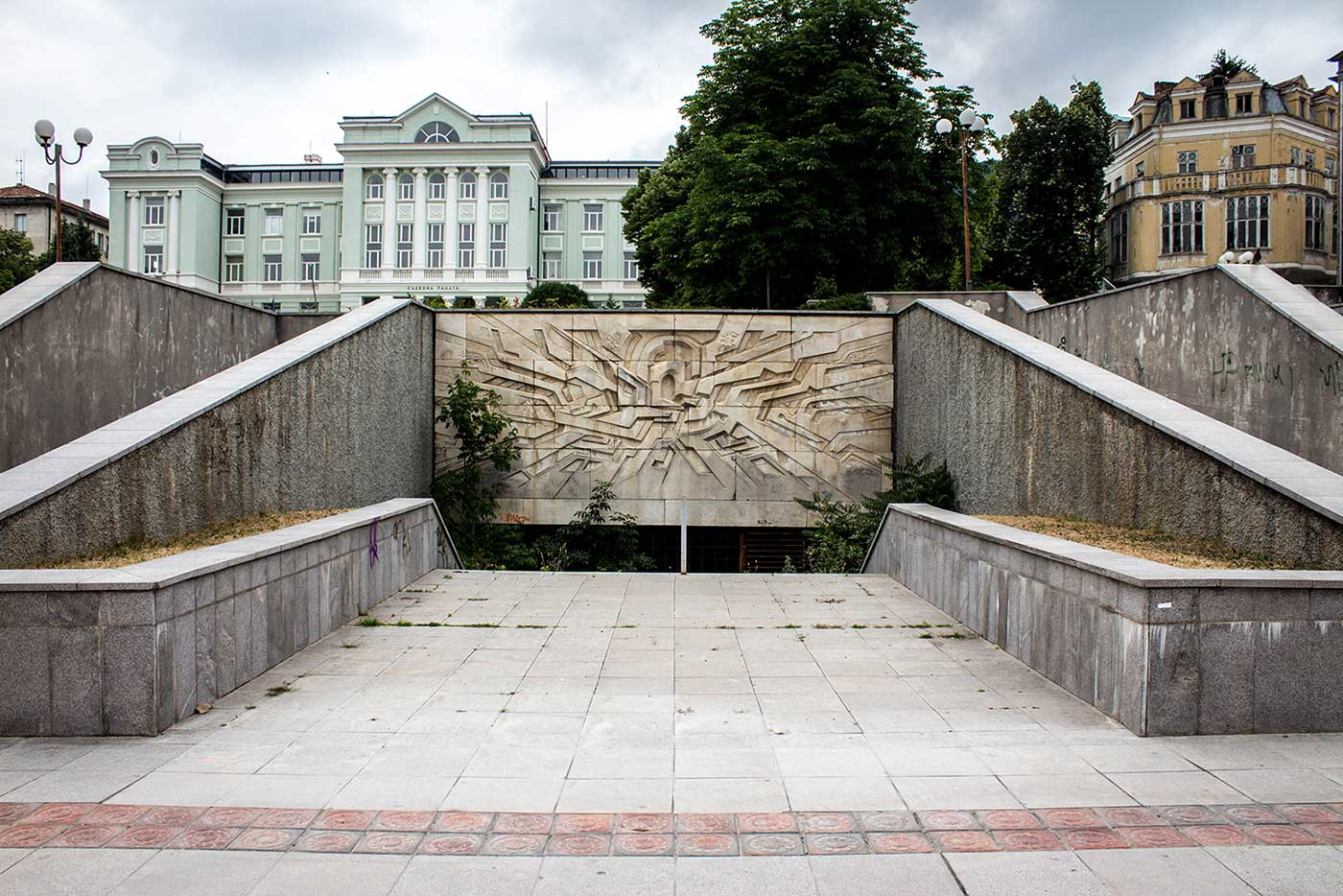 A modernist relief decorates one of the subterranean entrances to Central City Square, Shumen, Bulgaria.