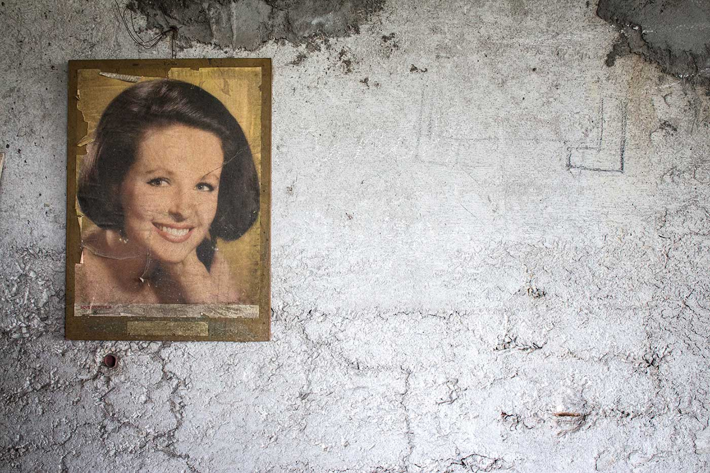 Faded portraits of Soviet movie stars, found inside Central City Square, Shumen, Bulgaria.
