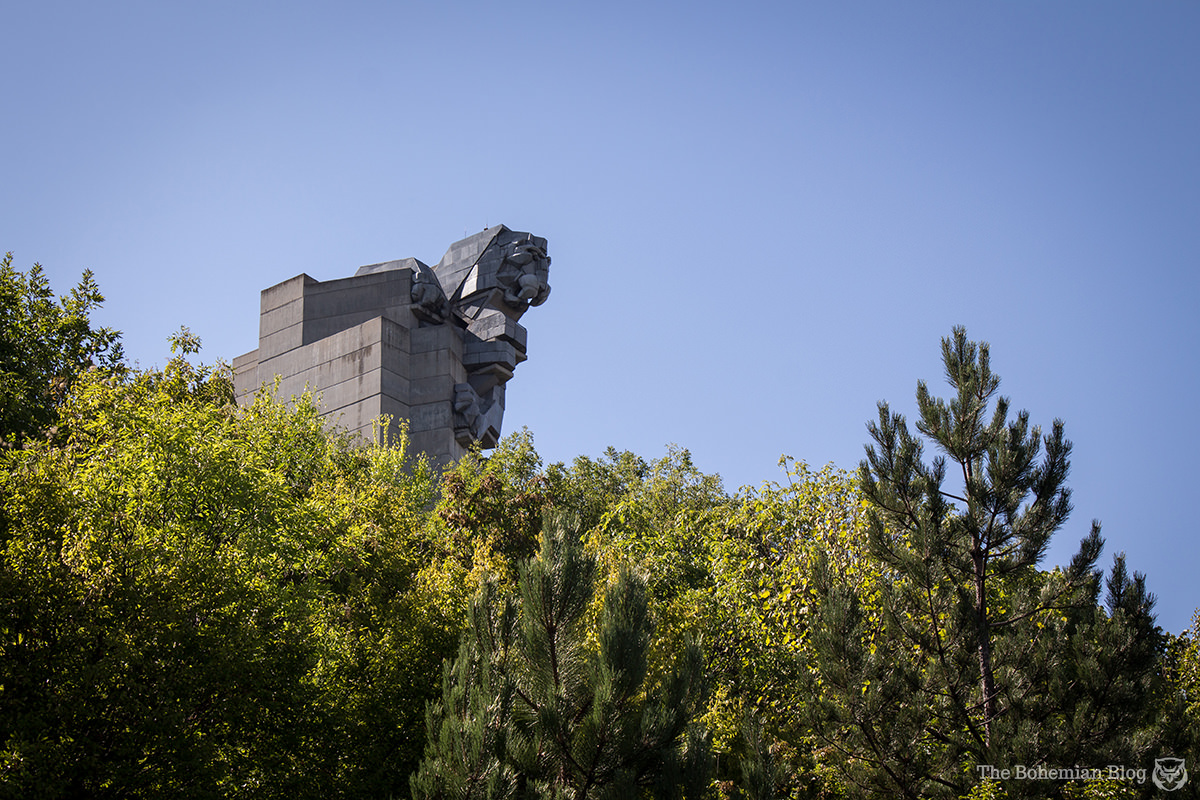 A black granite lion decorates the tallest column of the Monument to the Founders of the Bulgarian State. Shumen, Bulgaria.