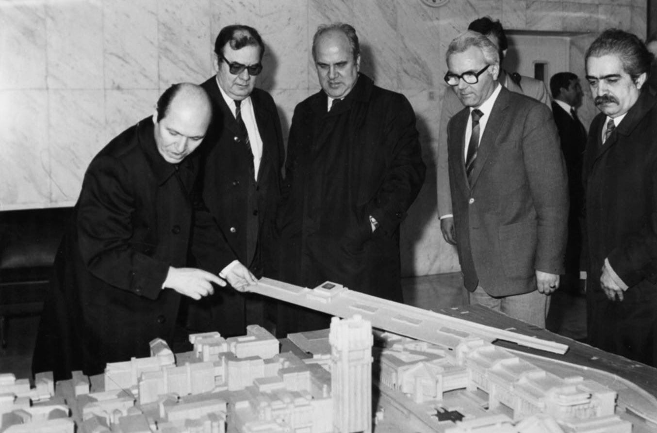 The architect Ivan Sivrev (right) stands beside a model of Central City Square in 1988.