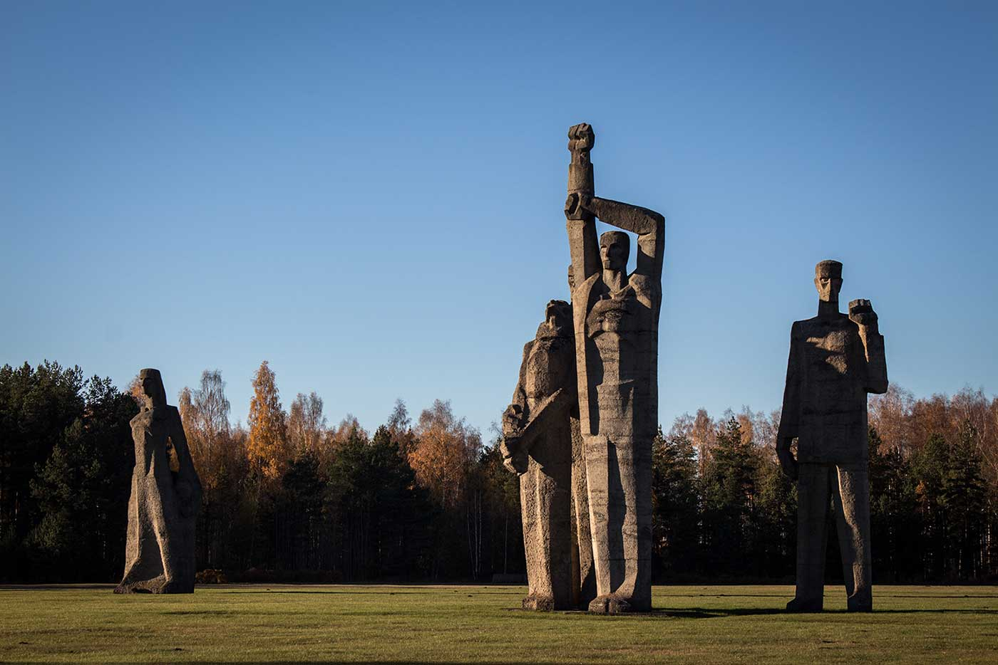 In the clearing beyond stands the Salaspils Memorial Ensemble. Salaspils Memorial, Latvia.