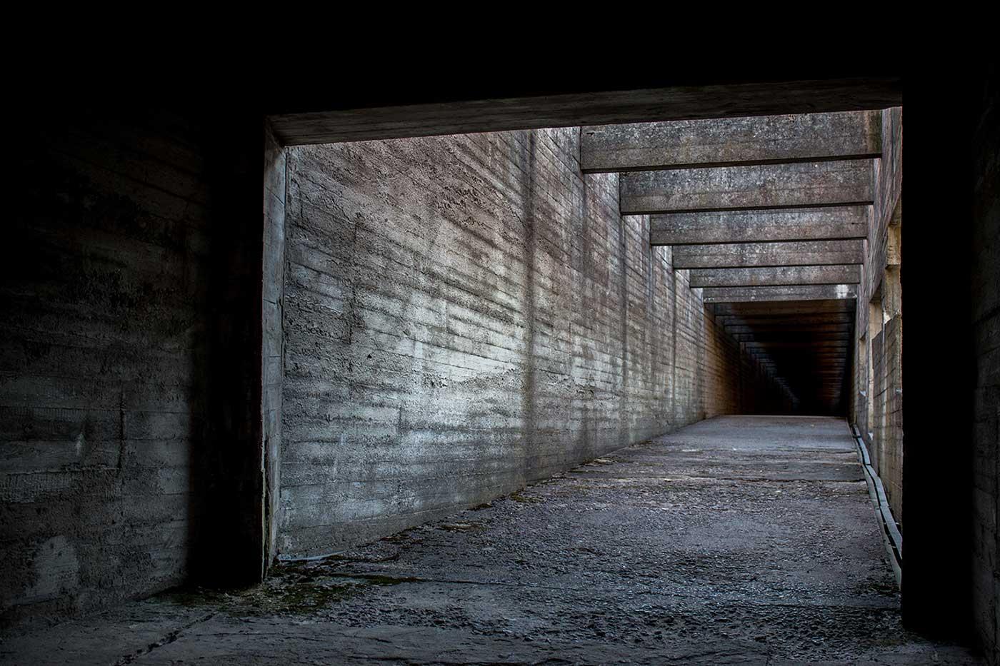 The walkway through the Brutalist gallery building. Salaspils Memorial, Latvia.