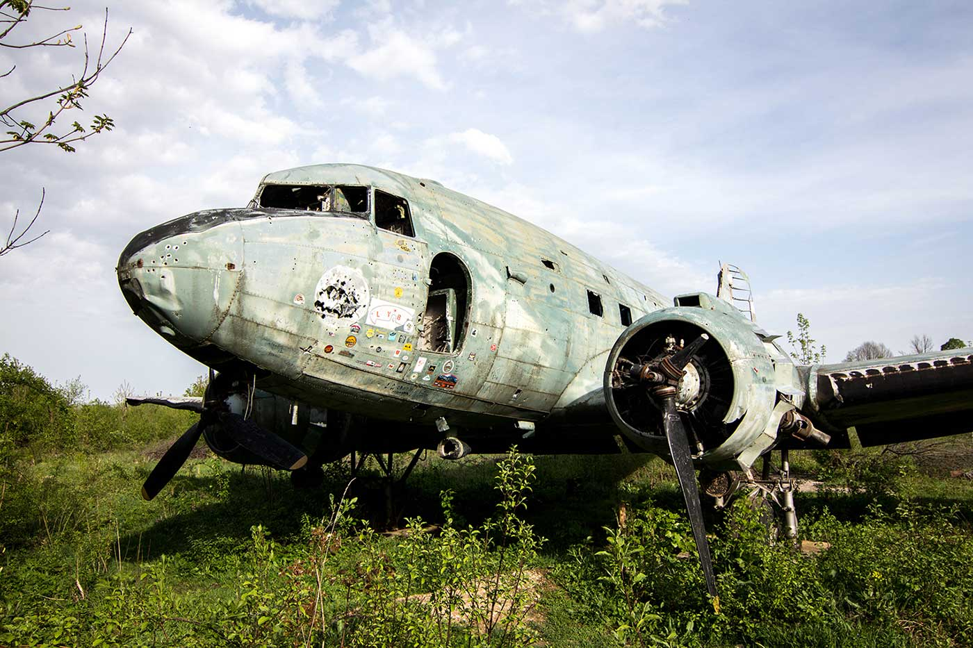 An abandoned Douglas C-47 near the former barracks. Yugoslavia's non-aligned status allowed its military to make use of both American- and Soviet-built aircraft. As late as 2012 there were reportedly also two American Republic F-84 Thunderjets left abandoned in the vicinity, though those have since disappeared. Zeljava, Yugoslavia.