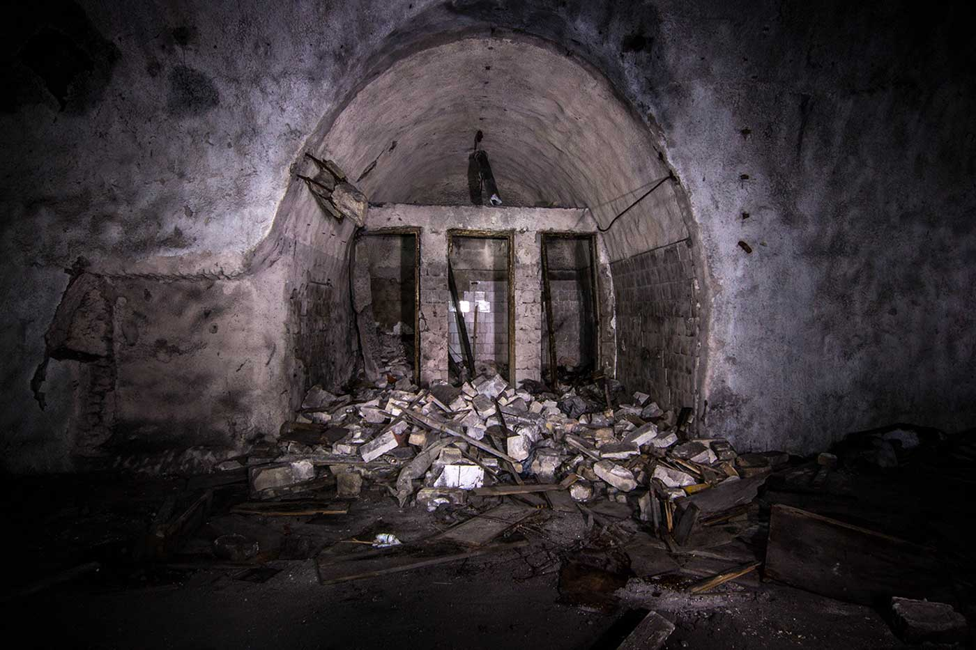 A collapsed toilet block inside the underground complex of Željava Airbase, Yugoslavia.