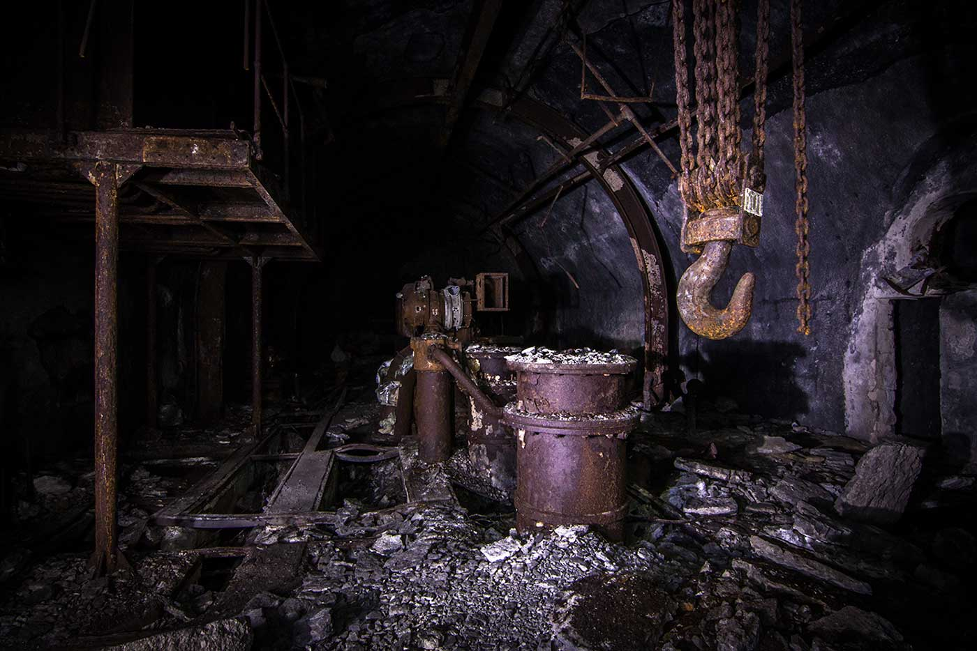 While the main galleries of the Željava Airbase have mostly been stripped bare, smaller side passages lead deeper into the mountain, to spaces that still contain rusted machinery and other original features.