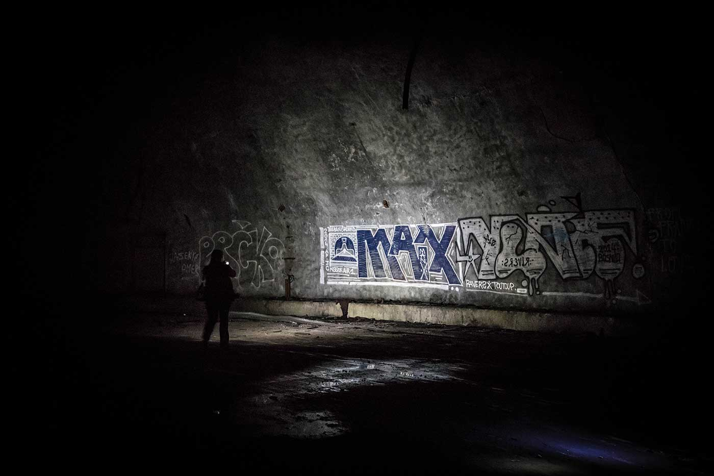 Graffiti inside the Željava complex. The deeper into the mountain you go, the less graffiti you find.