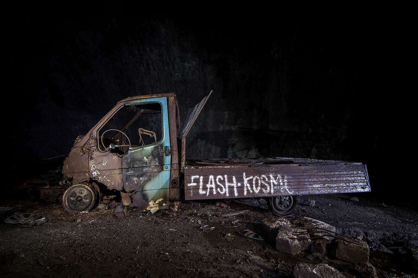 Burnt-out truck inside the former 'KLEK' complex. These 'Flash Kosmo' people seem to have been everywhere. Their tag appears on countless monuments and ruins throughout former Yugoslavia, and even at Buzludzha in Bulgaria.