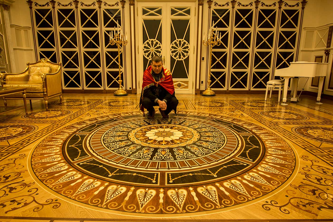 Petro shows off the elaborate craftsmanship of an inlaid wooden floor. Much of the building's furniture was imported from top-end Italian manufacturers (while the rugs were shipped from Iran), but these floors were 100% Ukrainian, using 17 varieties of wood sourced from around the country.